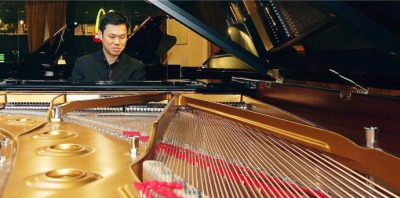 Play on: Wong is most at ease when he plays the piano.