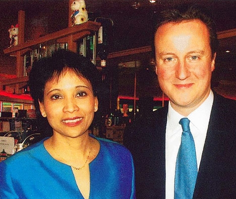 Taiping-born Loynton with British Prime Minister David Cameron