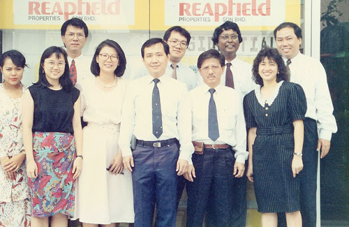 A young David Ong (back row far right) with his administration and sales team at Reapfield's old office in Damansara Jaya in 1993.