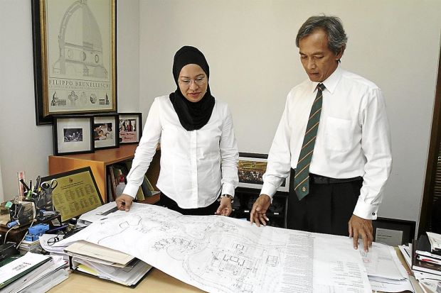 Climbing the ladder: Understanding research material instantly is important to architects Abdul Khalid and Zaiha.