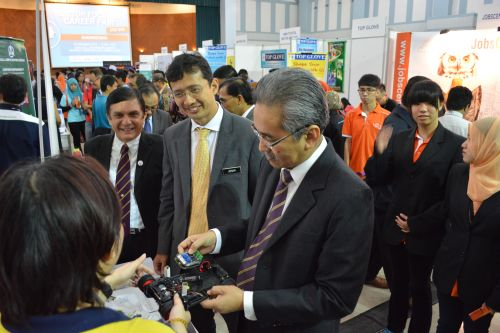 Johan Mahmood Merican, CEO of TalentCorp and Datuk Dr Omar Osman, Vice Chancellor of USM greeting each of the employer's present at the career fair.
