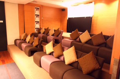 The AV and presentation room gives off a warm and inviting vibe.