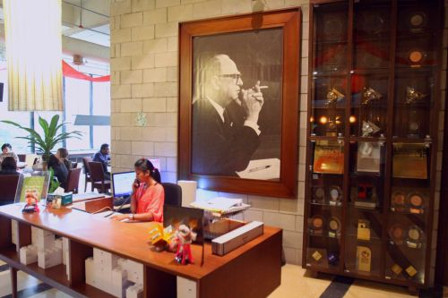 The entrance and reception of Leo Burnett featuring a potrait of the founding father, Leo Burnett himself, along with awards secured by the agency.
