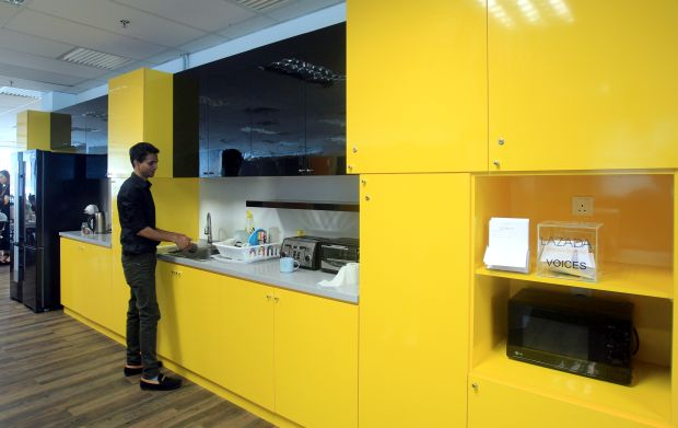 This dazzling yellow pantry adds a vibe of excitement and positivity to the workplace.
