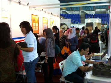 Jobseekers registering and applying jobs at MyStarJob.com booth during the Penang Career & Postgraduate Expo last year