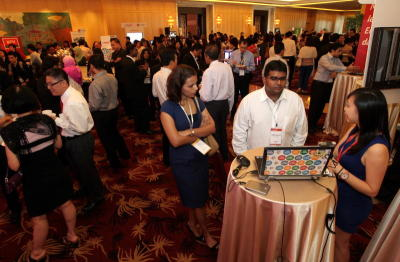 Melding of minds: Guests at the myStarjob launch mingling and visiting booths at the One World Hotel in Kuala Lumpur.