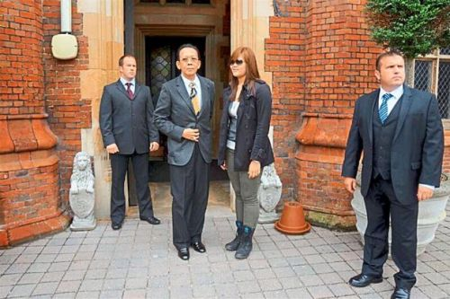 Pioneer spirit: Khoo (centre) and his daughter Niho visiting a London-based security training company.